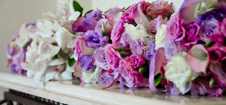 Purple and lavender roses, white lisianthus, hand-painted lavender mini calla lilies - by Vivid Occasions