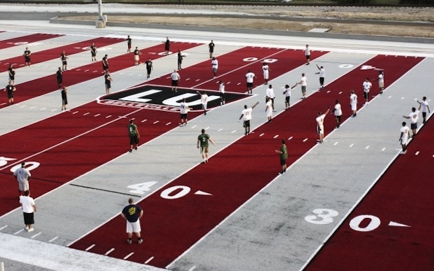 New football field? The article mentions how this field puts the BSU  smurf turf to shame! I personally think green turfs are overrated and creativity of schools can shine with their turfs! Although this one is kinda hideous!