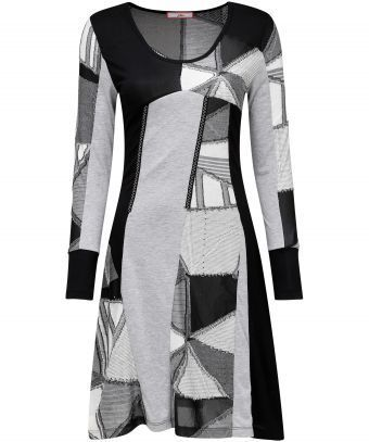 """We love playing with shapes and fabrics. This lightweight funky dress mixes textured panels to create a truly unique style. Approx Length: 94cm Our model is: 5'7"""""""