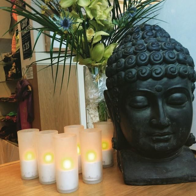 Light of candles and Buddha