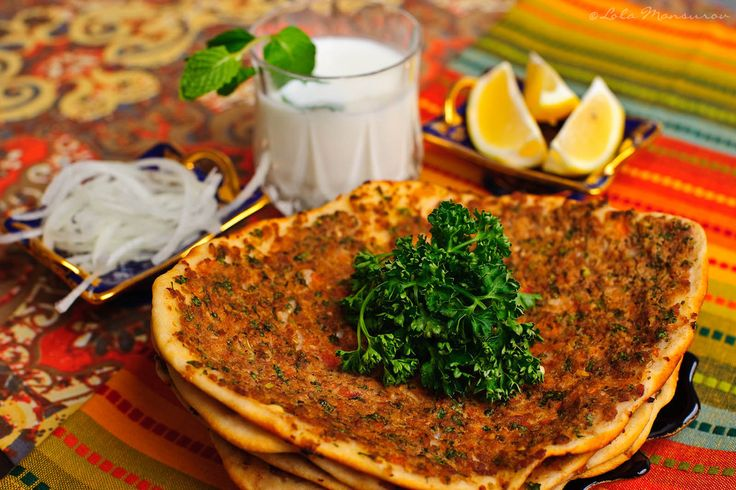 This pizza-like, thin, round dish, topped with herbs and minced meat also known as Turkish Pizza, Lahmajun and Lahmajoon, is very famous in Turkey. The smell, the taste and the healthy ingredients in Lahmacun impress me so much that it quickly became my all-time favorite Turkish dish. I love it so much that every time when we travel, I look for Turkish restaurants that serve Lahmacun.