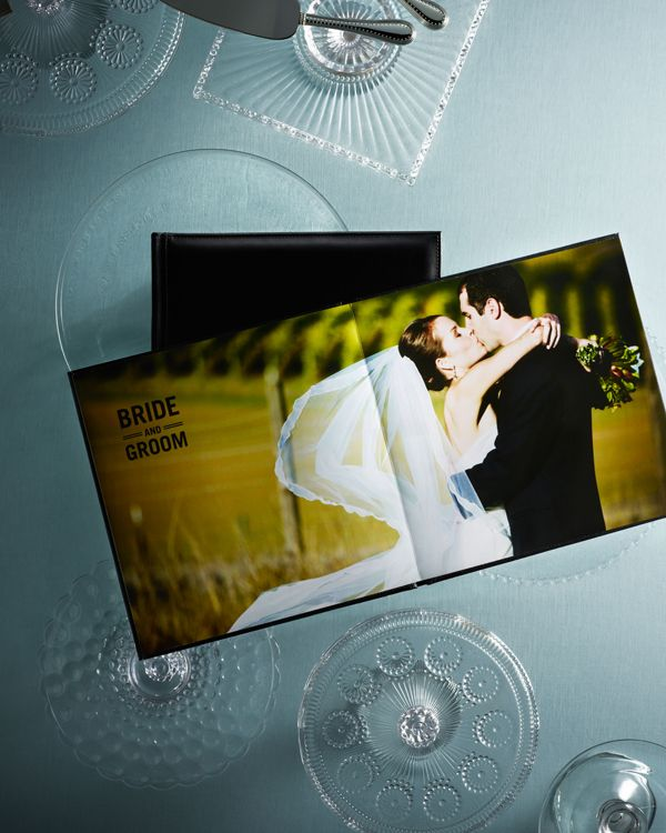 Wedding photobooks help guests relive the special moments the bride and groom have shared together | Shutterfly.com