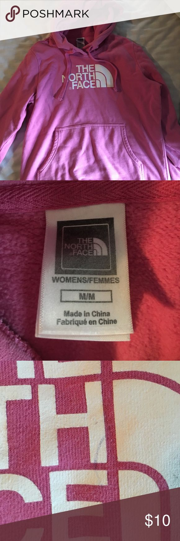 Pink The North Face hoodie Pink The North Face hoodie/ sweatshirt. Good condition other than the mark on the letter in the third photo. The North Face Tops Sweatshirts & Hoodies