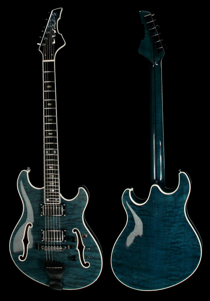 Go ahead and call me a hippie, but this is the most beautiful guitar ever. I would even trade in Misty if it would net me this beauty.