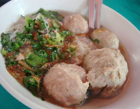 Bakso or baso is Indonesian meatball or meat paste made from beef. Bakso is commonly made from beef with a small quantity of tapioca flour, however bakso can also be made from other ingredients, such as chicken, fish, or shrimp. Bakso are usually served in a bowl of beef broth, with yellow noodles, bihun (rice vermicelli), salted vegetables, tofu, egg (wrapped within bakso), Chinese green cabbage, bean sprout, steamed meat dumpling, and sprinkled with fried shallots and celery. (WIKIPEDIA)