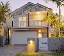 Modern Queenslander - greys, white trim with some stained timber balustrading