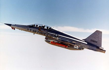USAF F-5F with AIM-9J Sidewinder, AGM-65 Maverick missiles and auxiliary fuel tanks over Edwards Air Force Base, 1976