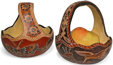 Gourd basket showing a butterfly and birds from Peru.  Perfect catch-all for little things around the house or office.
