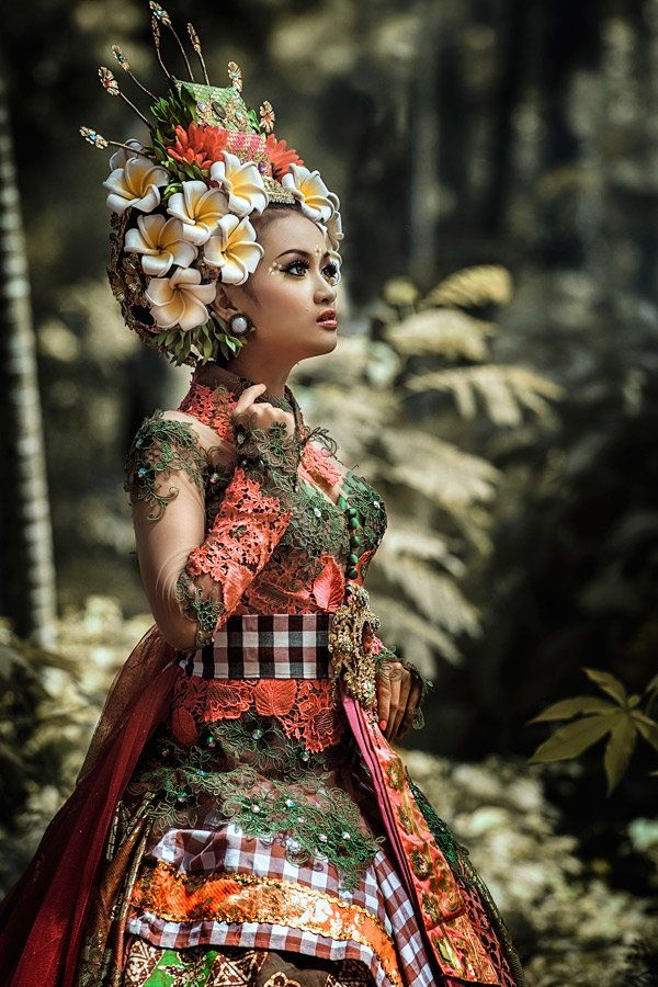 Bali, Indonesia - beautifully dressed and adorned young woman