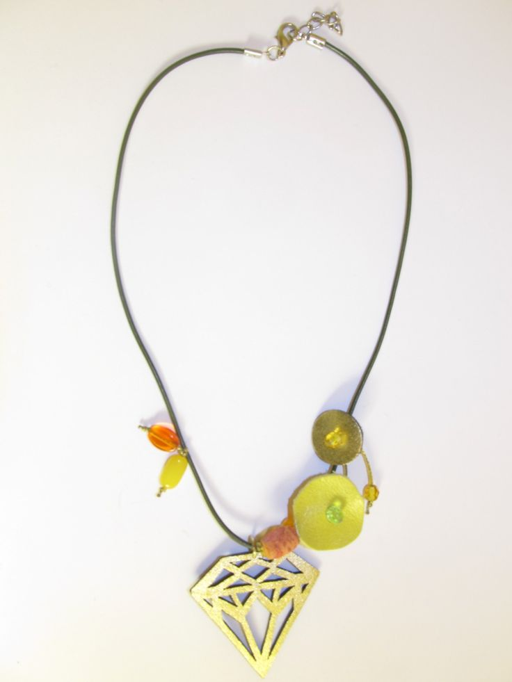 Handmade short leather necklace (1 pc)  Made with gold leather filigree, leather parts, olive leather cord, coral, glass beads and wax cord.