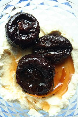Poached Prune recipe that is actually healthy! Poached in tea with a few tablespoons of sugar and some citrus zest. Turns the sweet dried plum into something gooey, warm and the perfect topping for yogurt or ice cream.