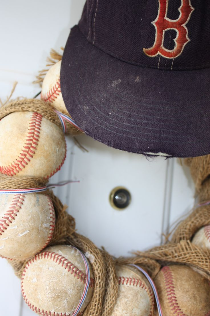 Make this easy baseball wreath. All it takes is a little (a lot ) of glue, a wire wreath form, and baseballs. No drilling!
