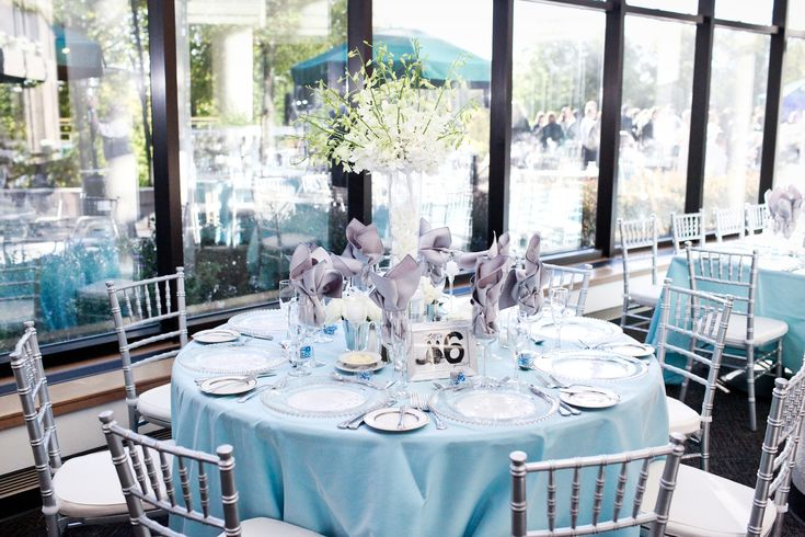 White tall centerpiece, light blue and silver wedding