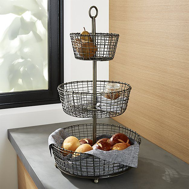 """Shop Rustic 3-Tier Fruit Basket. Tiered display and serving baskets are handcrafted of iron wire in a distinctive rustic """"weave"""" and finished in a multistep process of zinc plating, dipping and rubbing to create the beautiful, dark antiqued patina."""