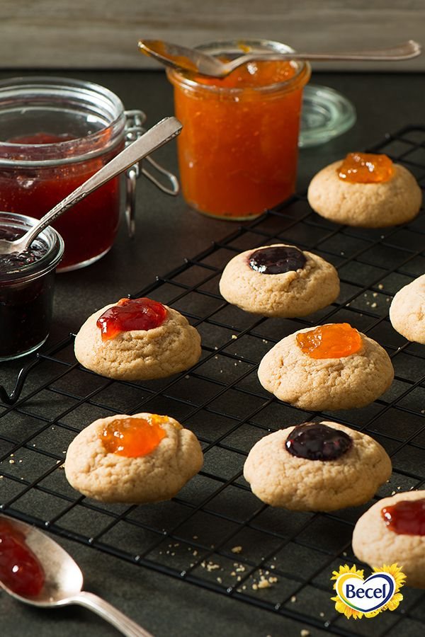 A thumbprint filled with your favourite jam tops our sugar-dusted Linzer cookies.