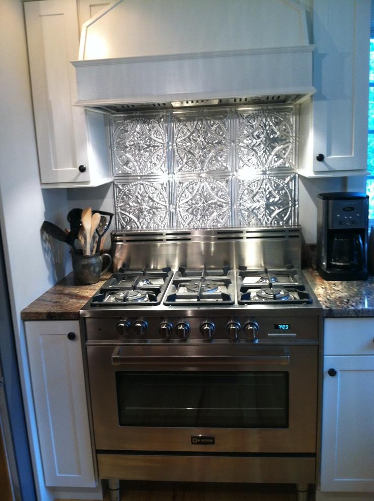 10 best images about metal backsplash on pinterest for Kitchen cabinets 24x24