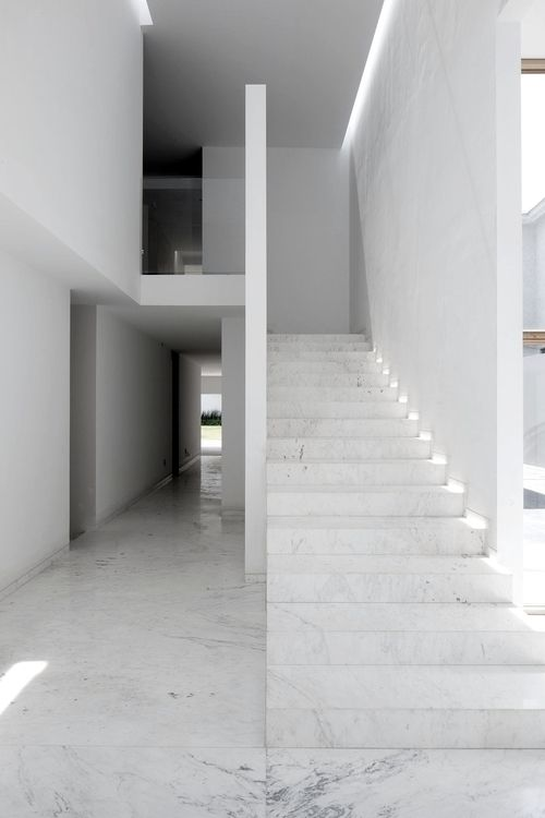 Casa AR is an exquisite white minimal residence in Mexico with striking volumes & planes.