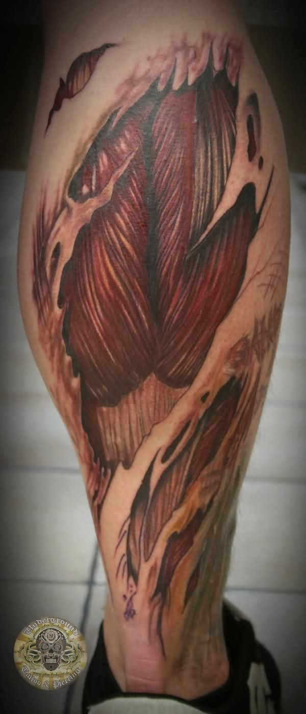 Ripped Skin Muscle Tissue Calf Tattoo http://tattootodesign.com/calf-tattoos/