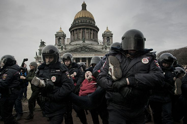 Police detain a protester demonstrating against the Russian military's actions in Crimea and developments in Russian-Ukrainian relations during an unsanctioned rally in St.Petersburg, Russia