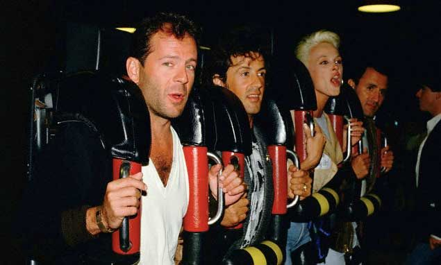 Bruce Willis, Sylvester Stallone, Brigitte Nielsen and Frank Stallone on a roller coaster