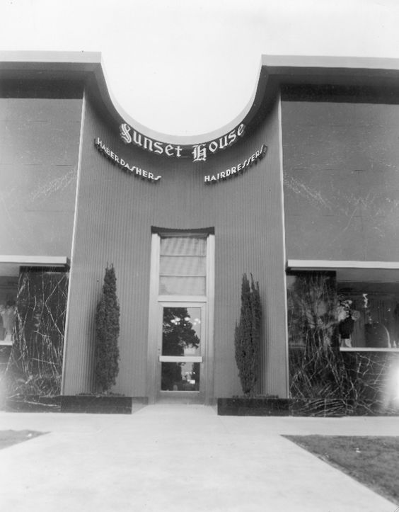 This photo shows us the signs for the haberdasher and hairdresser inside Sunset House, which was the Hollywood Reporter Building at 6715 Sunset Blvd, Los Angeles. I wish I'd found this photo 10 years ago—one of my novels protagonists works at the Hollywood Reporter and I may have set a scene or two at the in-house salons. How terribly convenient it must have been for publisher Billy Wilkerson to have a haberdasher and a hairdresser in the same building!