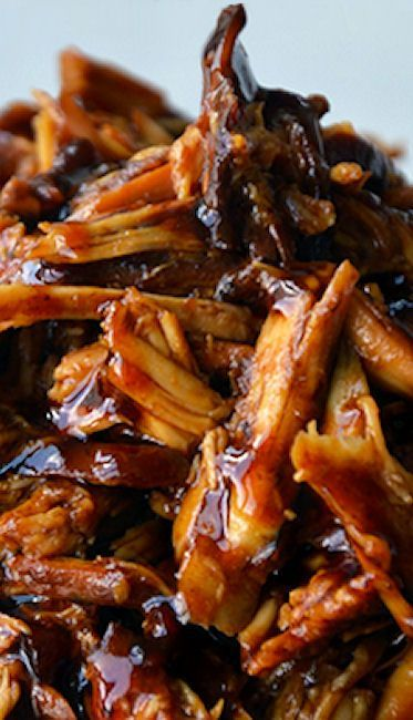 Slow Cooker Honey Garlic Chicken Recipe ~ now you can skip the takeout menus and slow cook your way to tender shredded chicken breasts tossed in a sweet and tangy sauce made with honey, garlic and soy sauce.