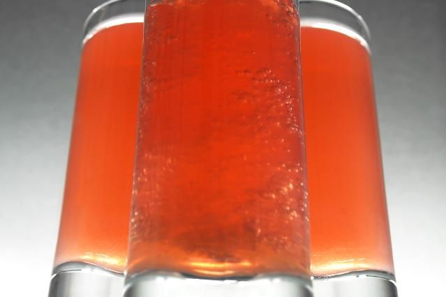 Shooter recipe for a Redheaded Slut, a popular shot drink of Jagermeister, peach schnapps and cranberry juice