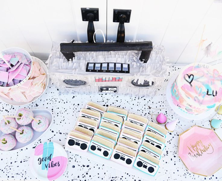 This 2nd birthday is bringing it back to the 80's, hip-hop style. Designed by mom + event planner, Leslie Bruce , who knew her days of planning birthdays were numbered, decided a pastel graffiti and Rapper's Delight infused shindig was perfect for little Lu. Next year might be
