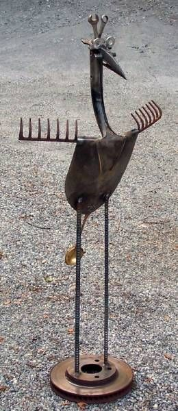 Garden art bird made from old tools