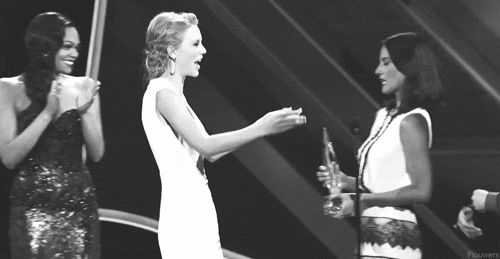 Taylor Swift giving what seems to be the world's most unwanted hug:   23 People Who Are Way More Awkward Than You