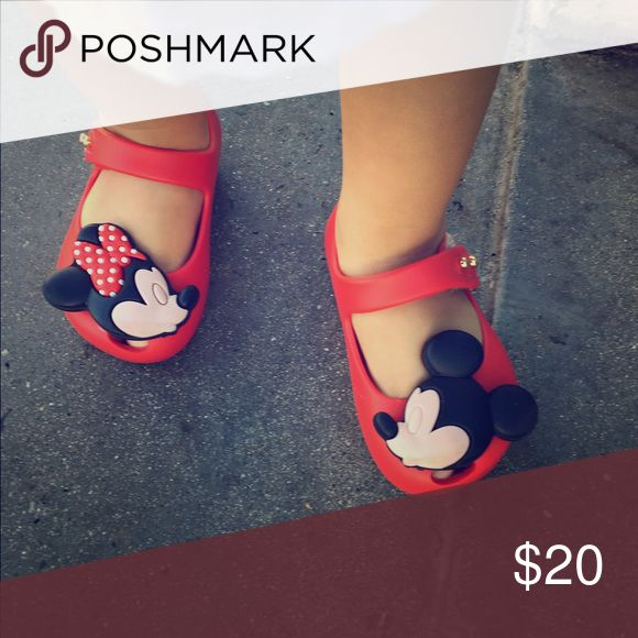 Toddler size 5 Minnie Melissa Disney edition Beautiful mini Melissa's with Mickey and Minnie on it great for a Disneyland adventure or a walk around the park. A couple of scuffs but still in great condition Mini Melissa Shoes Baby & Walker