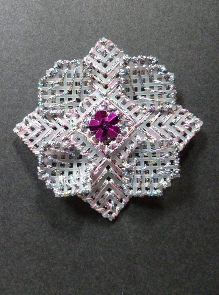 A Christmas tree decoration, made using plastic Aida, a flower sequin and embroidery thread.  November 1995.