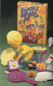 Double Dare!! We didn't have this but one of my friends did and I remember always playing it at her house. My brother had an electronic version of a pie toss DD game.