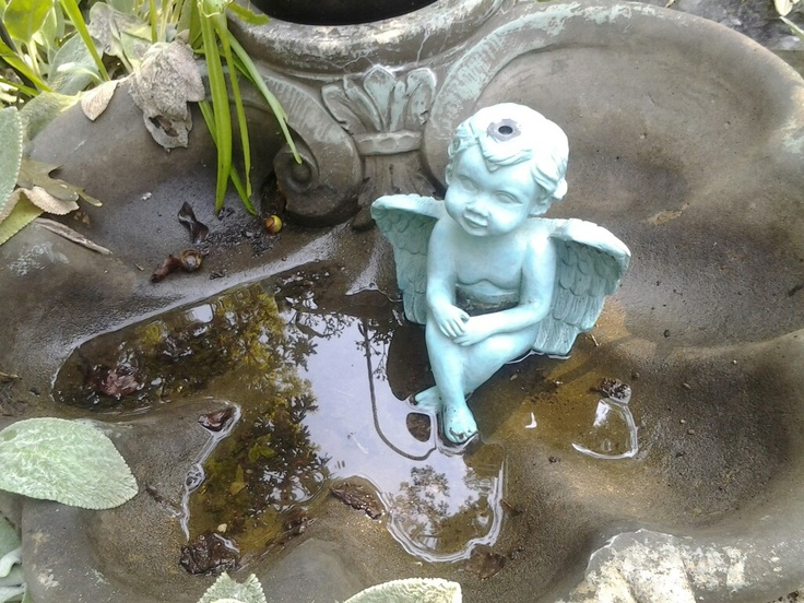 Cherub  dipping feet in fountain