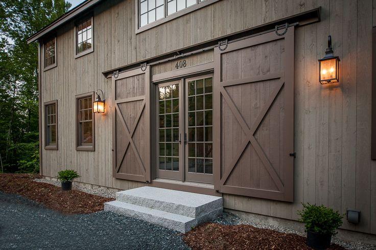 Barn door entry. Grantham Lakehouse Barn Home - Yankee Barn Homes