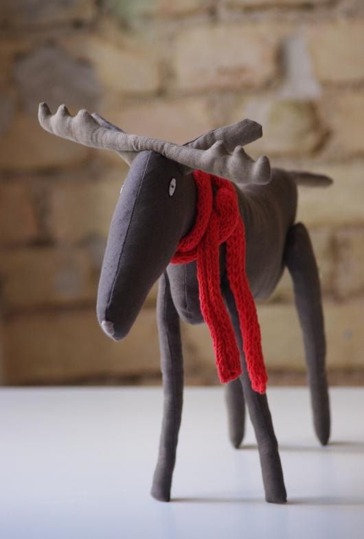 Moose made from natural linen. Inside - polyester stuffing.  * Hand embroidered body.  * Hand-knitted red scarf  Moose body ~ 45 cm - 17,7 inch The legs