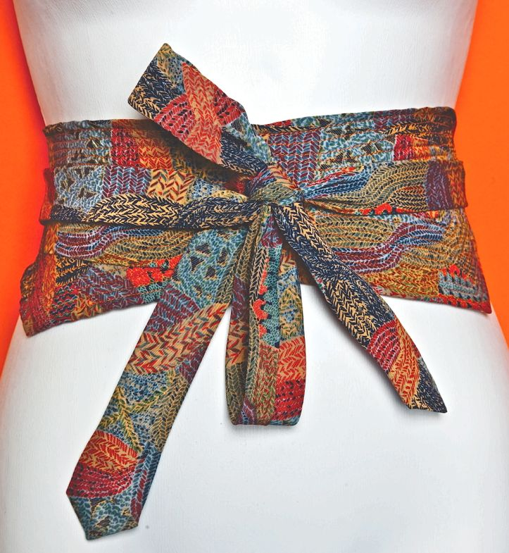 Learn how to make a Necktie Obi Belt and just see how terrific you look wearing it!  Great recycled project!