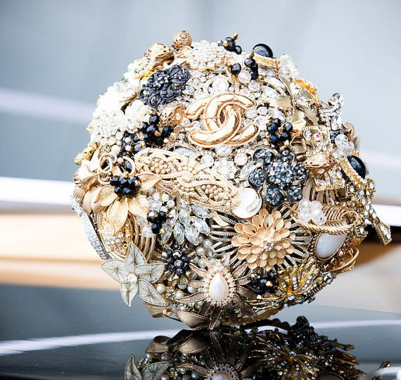 I woyld love one of these made kf navy and gold wedding brooch bouquet (by lillybuds)
