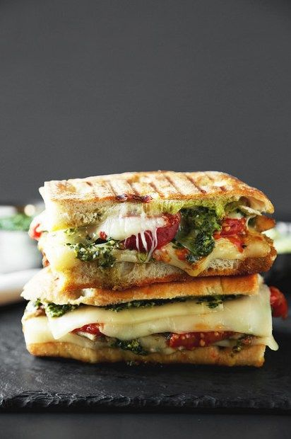 Grilled Chicken Pesto Panini is the ultimate lunch. Ciabatta bread stuffed with grilled chicken, pesto, avocado aioli, cheese, and roasted tomatoes!