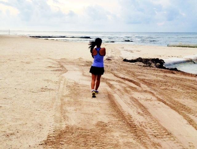 Early morning jog along the beach near Cancun.