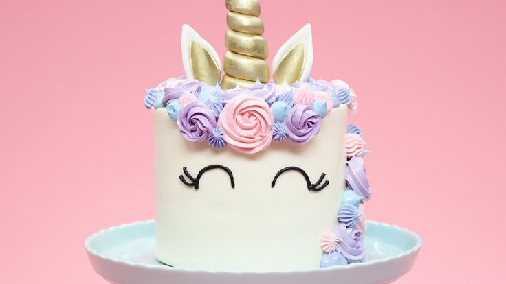 Here's the video I found AFTER I made a similar cake... -K  HOW TO MAKE A UNICORN CAKE - NERDY NUMMIES