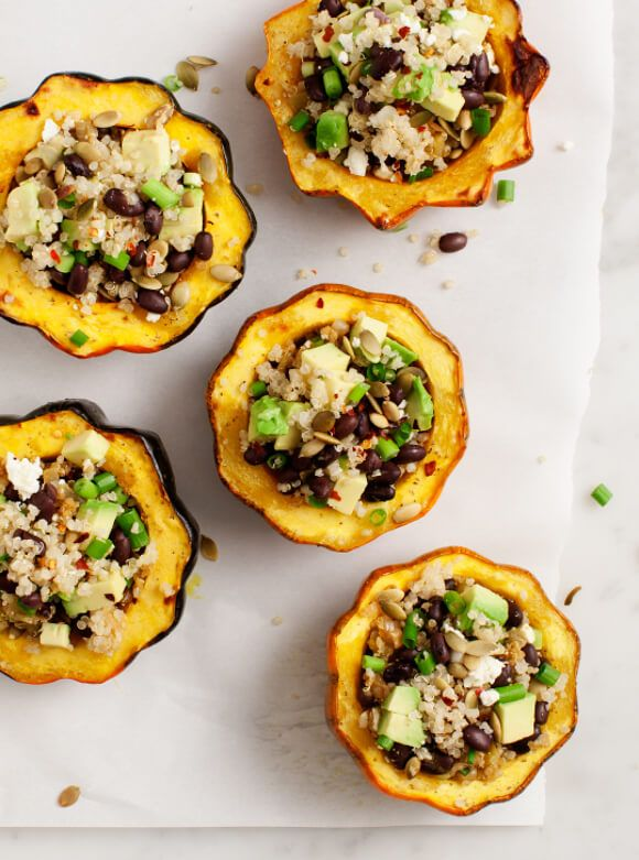 Avocado and Quinoa Stuffed Acorn Squash - Acorn squash filled with avocado, quinoa, black beans, pepitas, and chiles - a filling vegetarian (and vegan!) fall dinner or thanksgiving veggie main course.