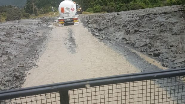 Flooding and slips on State Highway 7 through the Lewis Pass.