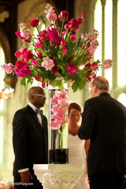 FOR ALTAR ARRANGEMENTS, LIKE BRIGHTNESS OF PINKS AND FUSHIA - LIGHTER PINK WOULD GO WITH BRIDAL BOUQUET AND DARKER PINK TO STAND OUT - ALSO LIKE THE FRESH GREEN LEAVES AND OVERALL FRESH STYLE OF ARRANGEMENT