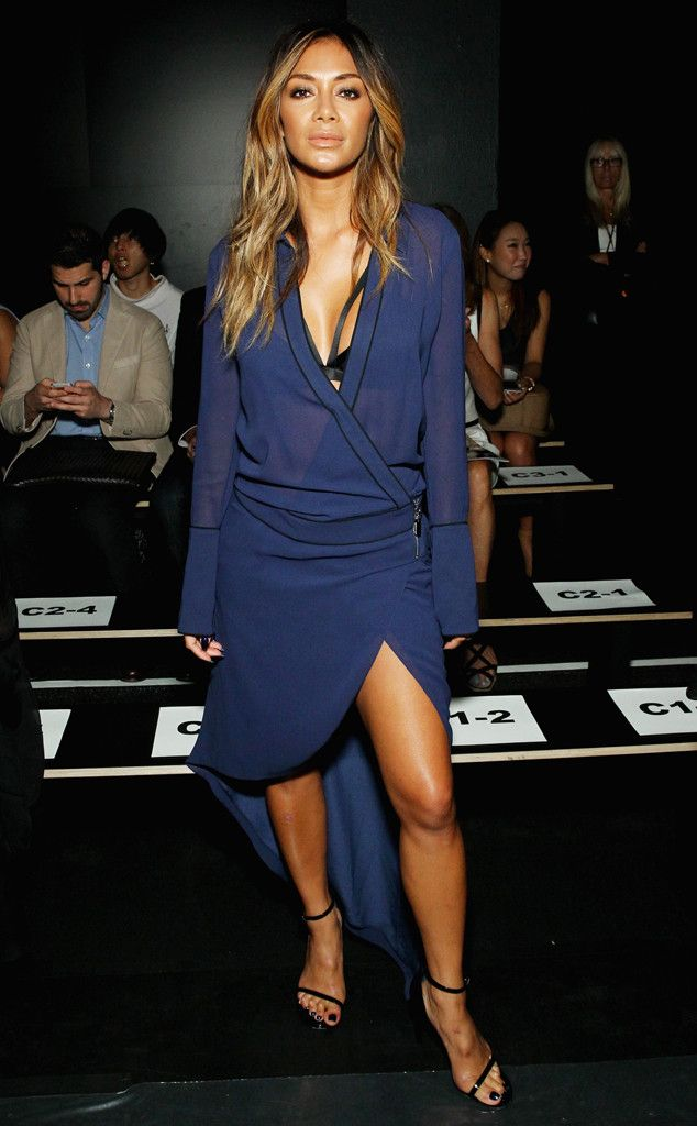 Nicole Scherzinger from Stars at New York Fashion Week Spring 2016 At the Thomas Wylde runway show, she wows in a sexy sheer wrap dress.
