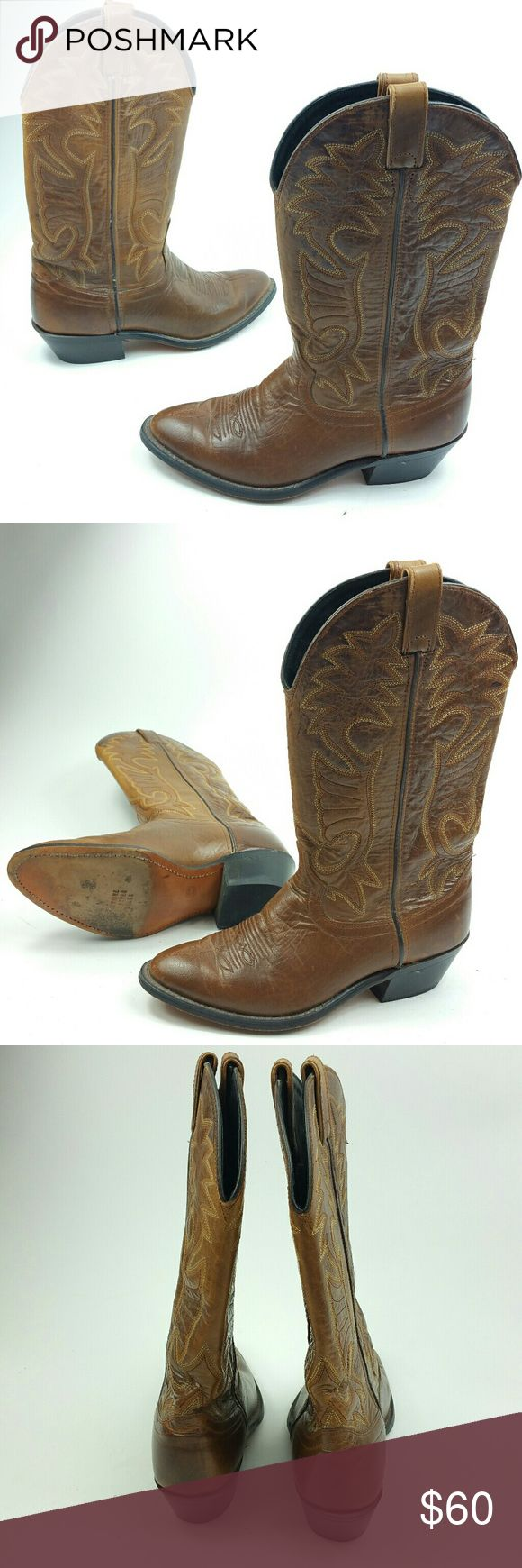 Laredo cowboy boots brown size 10 womens 7 mens Laredo cowboy boots brown size 10 womens 7 mens  Brown cowboy boots  Great shape Made in the USA  Size 7EE in mens which is a size 10 in womens  Measurements   Top to bottom 14in Sole top to bottom 10.5 Widest part of sole 4in Heel 2in Genuine buffalo sole Laredo Shoes
