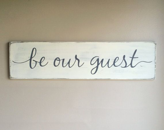 Hand painted wood sign, Be our guest.  *This sign is appx. 28 wide x 7.25 high. *The lettering is hand painted! *The base is a distressed white.