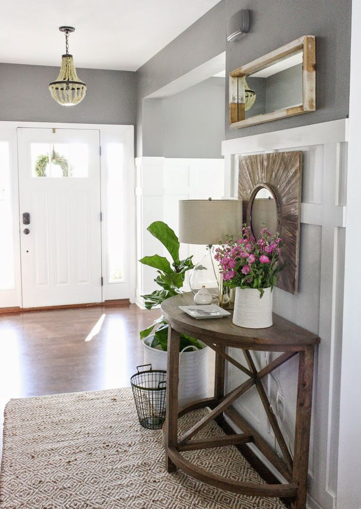 Entryway/console/fiddle leaf fig tree/mirrors.