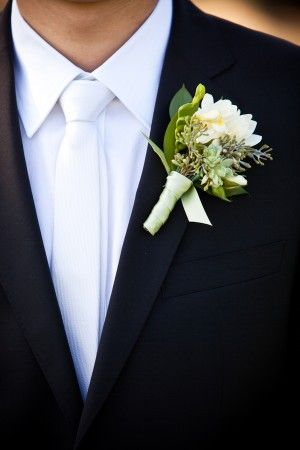 like his flowers with white ribbon added