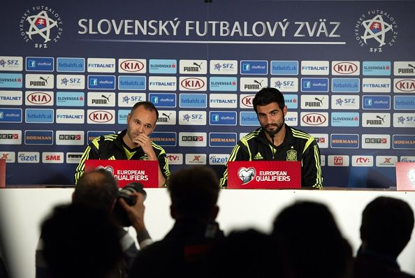 Spain's Andres Iniesta (L) and Raul Albiol attend a press conference after Spain national football team's practice on the eve of EURO 2016 qualifing match between Slovakia and Spain in Northern Slovakian town of Zilina on October 8, 2014.